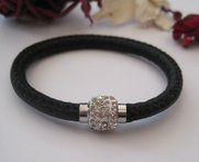 Black Crystal Magnetic Bracelet. A black Eco leather bracelet with a silver clear crystal magnetic fastening.£11.00