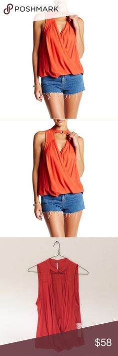 "Free People So Fine Tank A crew neck with ring accent flaunts pleated surplice draping in a woven tank. - Crew neck/surplice neck - Sleeveless - Approx. 22"" length  100% polyester Free People Tops Tank Tops"
