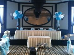 Teddy bear centerpieces with helium balloon table bouquets.
