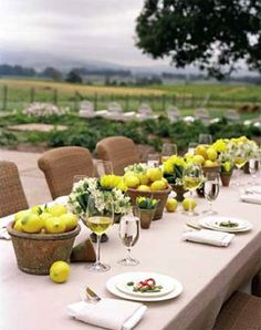 Vineyard dining - lemon pots. Would love to use fruit in my center pieces, maybe green apples and grapes...