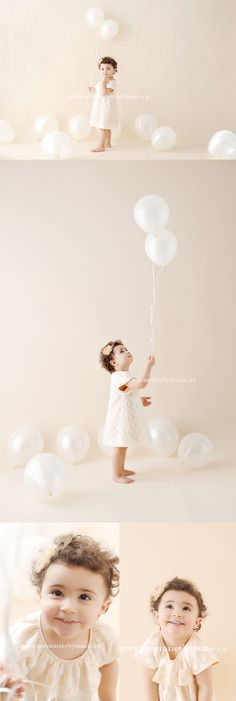 Toddler girl with balloons, cream beige backdrop