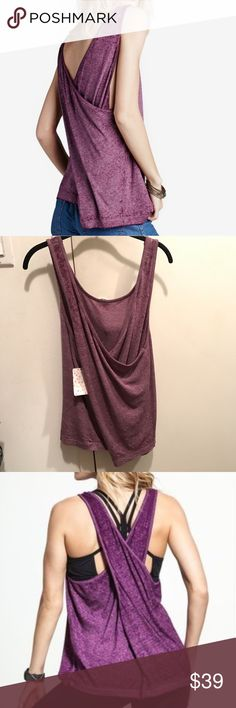 "Free People NWT Criss-Cross Burned Out Tank XS FREE PEOPLE, We The Free. NWT! 100% Authentic.  Cool Criss-Cross Back Tank makes this top a stunner. Burned out & slubbed cotton blend pliable fabric drapes. Pair this with strappy Free People's sexy lace bralette, galloon or brami's... they pair well and are stunning together.  FP's Color: ""Wild Orchid"" aka purple. Not vibrant as model pix- see my pix. Condition: NEW WITH TAGS. Size: XS.   GREAT STEAL! Free People Tops Tank Tops"