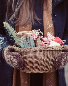Holidays Christmas: Woman Dressed in Winter Clothes Sprinkled with Snow Holding a Basket of Homemade Christmas Ornaments and Pieces of a Christmas Tree | #Holidays #Christmas