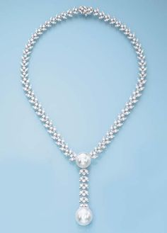 A DIAMOND AND SOUTH SEA CULTURED PEARL NECKLACE   The drop-shaped cultured pearl pendant measuring 18.4 x 17.0 mm to the brilliant-cut diamond leaf-surmount suspended from a button-shaped cultured pearl measuring 15.3 mm to the brilliant-cut diamond sides, mounted in 18k white gold, 43.0 cm long