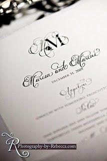 Black and white wedding invitation - love the monogram!