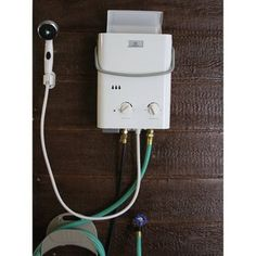 Camp with the convenience of hot water for cooking or cleaning with this portable tankless water heater from Eccotemp. Use 2 D-cell batteries and a standard BBQ propane tank to fuel this BTU wa Douche Camping, Rv Camping, Camping Hacks, Glamping, Camping Shop, Do It Yourself Camper, Accessoires 4x4, Vw Lt, Outdoor Bathrooms