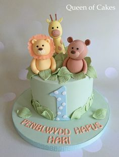Pastel jungle baby boy 1st birthday cake                              …