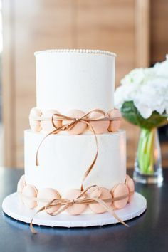 Wedding cake with sweet macarons! we ❤ this! moncheribridals.com #weddingcake #weddingmacarons #whiteweddingcake