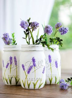 *****DUE TO VOLUME OF ORDERS, YOUR ORDER WILL NOT ARRIVE IN TIME FOR EASTER. MY APOLOGIES.***** Set of three pint-sized mason jars hand painted and distressed in lavender flowers. Perfect gift idea for Mothers Day or weddings. Great for centerpieces at events, like weddings, baby showers, birthday parties. The insides of the jars are not painted, so it's okay to put water in them. The exteriors have been sprayed with a matte enamel protective coat. Do not submerge in water or put in…