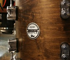 DW PDP Classic Badge...  http://www.drumshop.co.uk/collections/acoustic-drum-kits/products/pdp-cm-classic-4-piece-walnut-with-natural-hoops-shell-pack