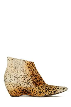 Supremely rad ponyhair ankle boots featuring an ombre animal print and angled ankle opening. Side zip closure, low wedge heel. Fully lined.