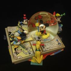 """Plays """" MICKEY MOUSE MARCH """" tune. 