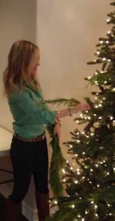 Add real greenery to the faux tree to fill the gaps and add a living element. The fresh scent helps, too. Add holly, real berry branches, magnolia leaves, etc.