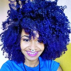 blue afro natural hair with pink lipstick
