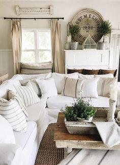 A lovely neutral farmhouse style living room. A great pin for tons of farmhouse and cottage style decor inspiration.