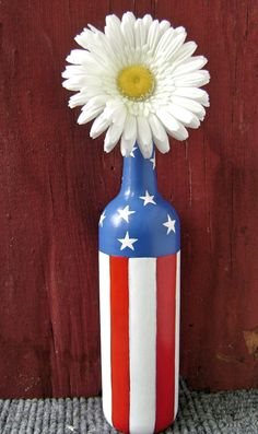 This beautiful vase makes a great center piece to celebrate the 4th and add a touch of patriotism all year round. I hand painted it with enamel acrylic paint making it safe to hand wash. The vase can hold fresh cut flowers, fake flowers, or stand on it's own. It is just under 12 inches tall and about 9 1/2 inches around.