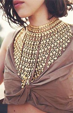 A gold cascade by Miss Yolanda | Karla's Closet