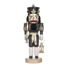 Black and Gold King. Dark natural stained wooden nutcracker King. Traditional Erzgebirge design.