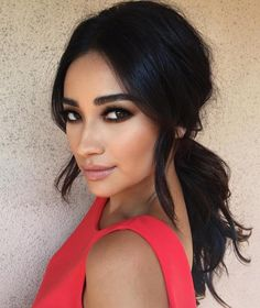 Shay Mitchell's amazing brown/black smoky eye + low ponytail with volume on the back is always a safe bet