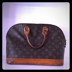 Louis Vuitton alma Pre-owned Louis Vuitton Alma. Purchased pre owned a couple years ago from luxedh.com, that website guarantees authenticity but I also took it to my local LV store and had it authenticated as well. Has some wear as you can see in the pictures but no tears or anything major. Small pen mark and lip gloss stain on inside of bag. Zippers work great.Check my closet for additional post with more pics make offer  Louis Vuitton Bags