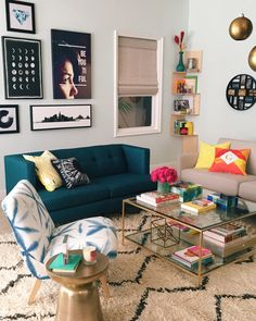 Relax and rejuvenate in a modern, geometric living room space. Filled with…