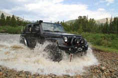 Black Jeep Wrangler Unlimited with snorkel air intake.