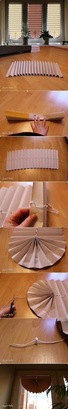 DIY window covering using large sheets of paper - wonder if handmade rice papers would work, or if they would be too soft to maintain the folds. Let me know if you try this!