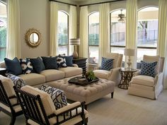 I like the taupe furniture with gray and blue accents.