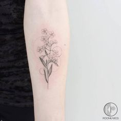 Single needle Forget-me-nots tattoo on the left inner forearm.