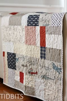 The Lazy Quilters Quilt - No Measuring Required! - I LOVE this! She collected a bunch of boy fabrics she liked, then laid out her backing and started cutting random shapes and sizes from the fabrics and piecing them roughly together on the backing to fill the space.