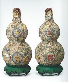 """Matching set of capped intricately carved ivory gourd Vases, inscribed with two Chinese characters.  The left gourd  read """"Great Luck"""" (Da Ji) while the right side translated characters read, """"Happiness"""" ('Xi').  Crafted during the Yongzheng to Qianlong eras (1723-1795 AD), Qing Dynasty.  Height: 18.8cm; Width: 2.8cm."""