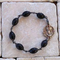 Bronze King Medallion with Cross,Rubies and Lava Beads bracelet by Roman Paul. #romanpaul
