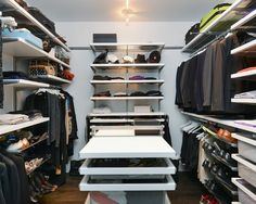 This spacious master bedroom closet features ample shelving and hanging space, making it easy to stow away clothing, shoes and other accessories. A center island storage area creates a functional space for assembling items. Closet Island, Wardrobe Room, Remodeling Companies, Master Bedroom Closet, Master Suite, Kitchen And Bath Design, Storage Hacks, Storage Area, Closet Designs
