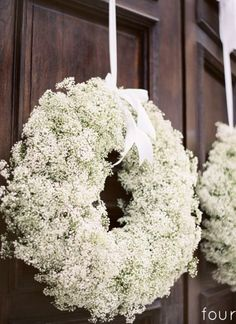 Baby's breath wreathed with bows for the Mr. And Mrs. Chairs would be lovely