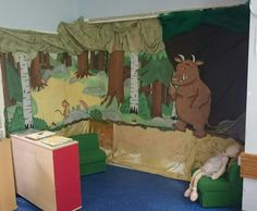 Gruffalo reading corner ready in my classroom.  Background and characters painted on giant cardboard with various materials to decorate :)