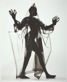 Irving Penn, Woman in a Miyake Raincoat (A), New York, December 9, 1998