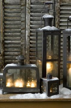 Snowy Lanterns - would love this collection on the porch at night.