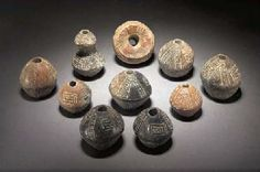 Cyprus - MAINLY DRAB POLISHED WARE POTTERY SPINDLE WHORLS   MIDDLE BRONZE AGE, 1900-1650 B.C.   Comprising sixteen Drab Polished Ware spindle whorls of bi-conical form, another of waisted 'hour-glass' form; two Incised Red Polished Ware spindle whorls of conical form; two Black Slip Ware spindle whorls of bi-conical form, all with incised decoration; three White Painted Ware conical-shaped spindle whorls with encircling black lines, Iron Age, 1050-750 B.C.; a small picrolite spindle whorl