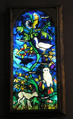 """Stained glass by John Piper, Magdalen College Chapel, Oxford -The window represents the Nativity. The animals and birds are saying in Latin: """"Christ is born this night in Bethlehem"""". Rather beautiful."""