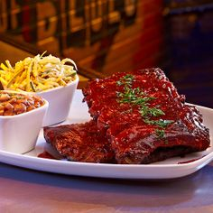 St. Louis Ribs Slow cooked rack of ribs rubbed with Adobo spice covered in smoked tomato BBQ sauce, served with BBQ baked beans and housemade coleslaw #Ribs #BBQ