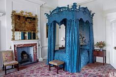 Dumfries House: A team of 20 artisans restored the Chippendale four-post bed in the Family Bedroom; brilliant blue silk damask covers even the canopy's cresting. Above the fireplace is a gilt-wood overmantel, also by Chippendale; Alexander Peter designed the bedside cupboards as well as the chair and stool, which retain their 18th-century floral tapestry covers.