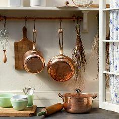 Hand-Hammered Copper Saucepans and Jadeite bowls. Nice.