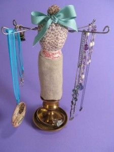 use a barbie doll to create this jewelry stand