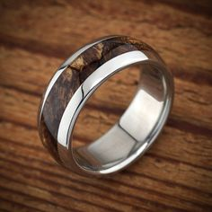 Classy and elegant. https://www.etsy.com/listing/223540240/titanium-wood-wedding-band-spalted-maple