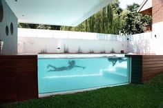 A thorough look at Argentina's Casa Devoto House by Andres Remy Architects, with its unusual above ground swimming pool design and modern interior design.