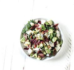 Chopped Salad and Dressing (Salad: kale, raddichio, cabbage, turkey, bacon, apple, almonds and cheese. Dressing: Olive oil, vinegar, garlic, honey, Dijon)