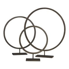 """Crate & Barrel Circlet Stand - see other pin for DIY version from embroidery hoops -  Handwrought iron round with rustic hand patina takes a geometric stance. Choose one of three sizes, or cluster all three for maximum effect.  Large Stand. 20""""Wx3.5""""Dx23""""H  Medium Stand. 16.5""""Wx3.5""""Dx19""""H  Small Stand. 12""""Wx3.5""""Dx15""""H"""