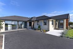 Jennian Homes West Coast Display Home. Hardwood Decking, Display Homes, Open Plan Living, Home Builders, West Coast, Living Area, New Zealand, House Plans, Brick