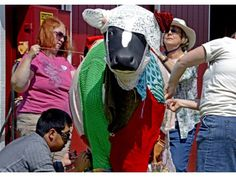 Yarn bombers, from bottom left clockwise, Anthony Pham of Westminster, Marcia King of Irvine, Diana Rishel of Westminster and Patty Nance of Anaheim Hills cover a cow statue near Centennial Farm with yarn Sunday at the OC Fair. PHOTO BY MICHAEL GOULDING, THE ORANGE COUNTY REGISTER