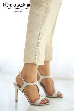 Gold jamavaar cigarette trousers With pearl buttons on sides.